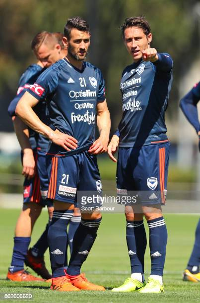 Carl Valeri and Mark Milligan of the Victory talk during a Melbourne Victory ALeague training session at Gosch's Paddock on October 18 2017 in...