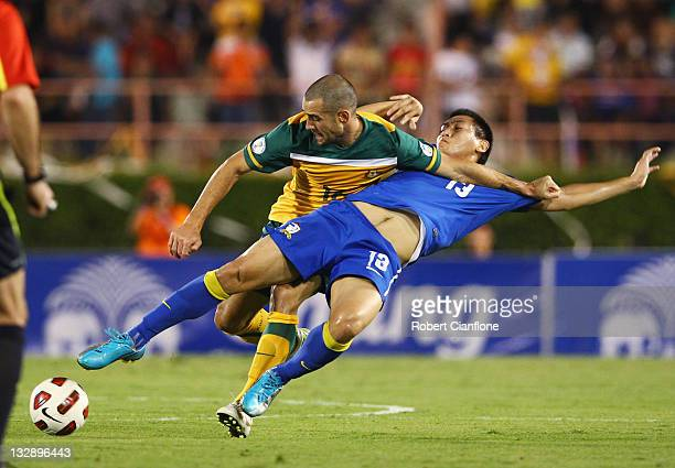 Carl Valeri of Australia is challenged by Kirati Keawsombut of Thailand during the 2014 FIFA World Cup Asian Qualifier match between Thailand and the...