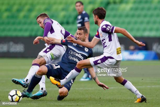 Carl Valeri of Melbourne Victory and Alex Grant of Perth Glory compete for the ball during the round 16 ALeague match between the Melbourne Victory...