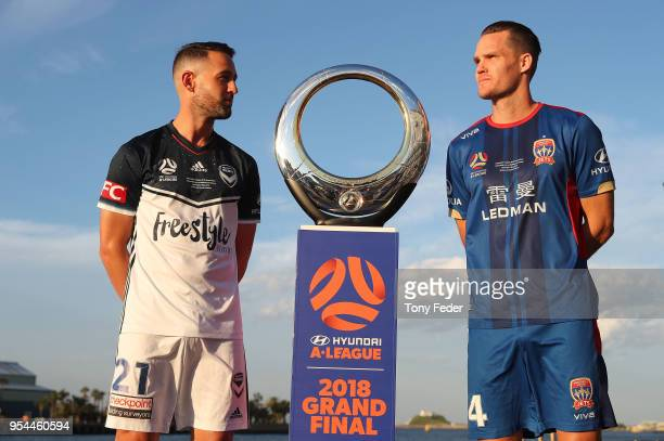 NEWCASTLE AUSTRALIA MAY Carl Valeri of Melbourne Victory and Nigel Boogaard of the Jets pose with the Hyundai ALeague Champions Trophy at the...