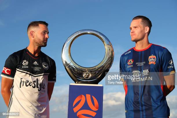 Carl Valeri of Melbourne Victory and Nigel Boogaard of the Jets pose with the Hyundai ALeague Champions Trophy at the Newcastle waterfront during a...