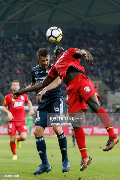 Carl Valeri of Melbourne Victory and Papa Baba Diawara of Adelaide United compete for the ball during the ALeague Elimination Final match between...