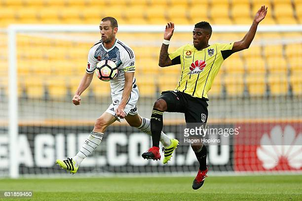 Carl Valeri of Melbourne Victory controls the ball under pressure from Roly Bonevacia of the Phoenix during the round seven ALeague match between the...