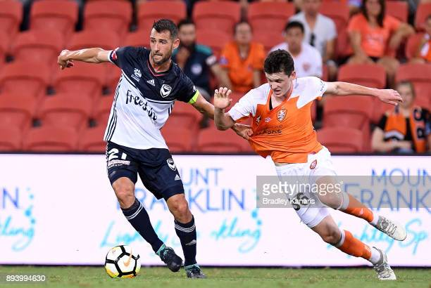Carl Valeri of the Victory and Andre Jannese of the Roar challenge for the ball during the round 11 ALeague match between the Brisbane Roar and the...