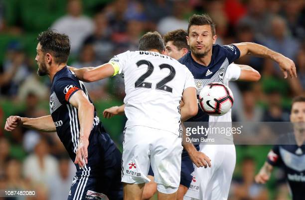 Carl Valeri of the Victory Andrew Durante of the Phoenix Kosta Barbarouses of the Victory compete for the ball during the round 10 ALeague match...