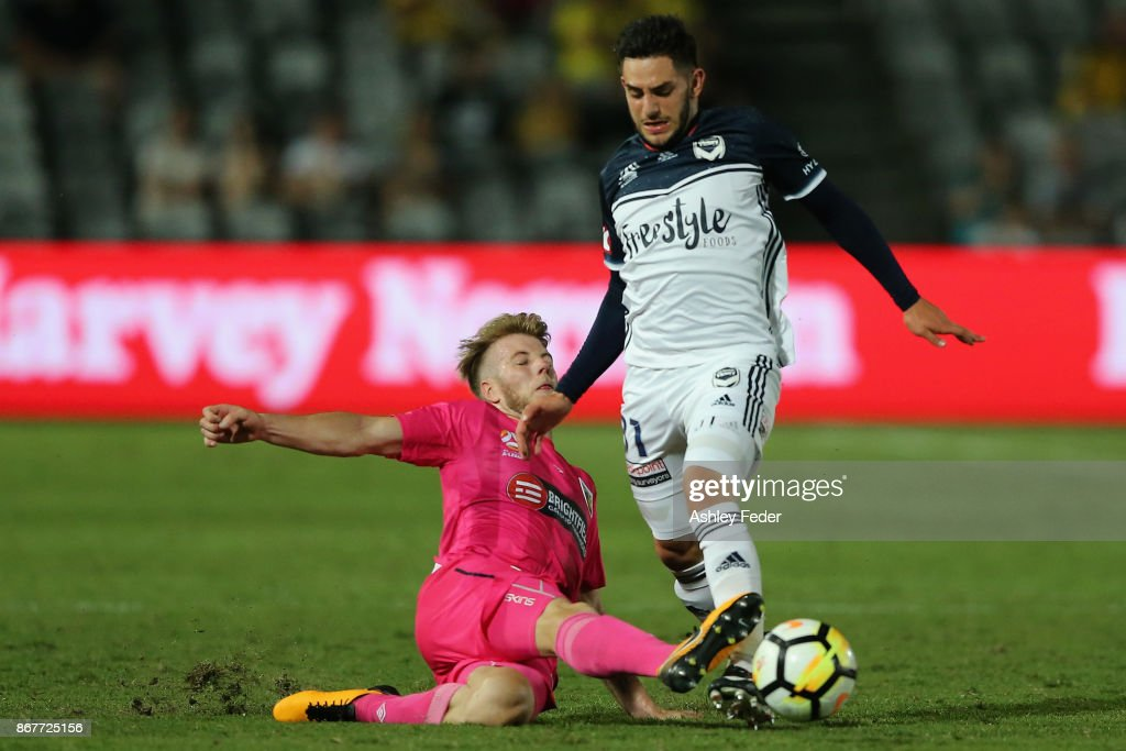 Carl Valeri of the Victory contests the ball against Andrew Hoole of the Mariners during the round four A-League match between the Central Coast Mariners and the Melbourne Victory at Central Coast Stadium on October 29, 2017 in Gosford, Australia.