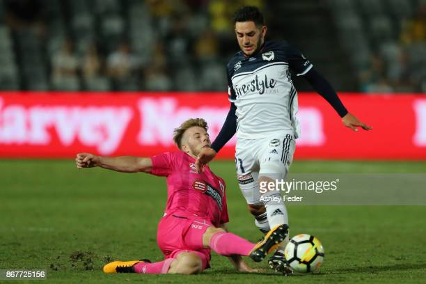 Carl Valeri of the Victory contests the ball against Andrew Hoole of the Mariners during the round four ALeague match between the Central Coast...