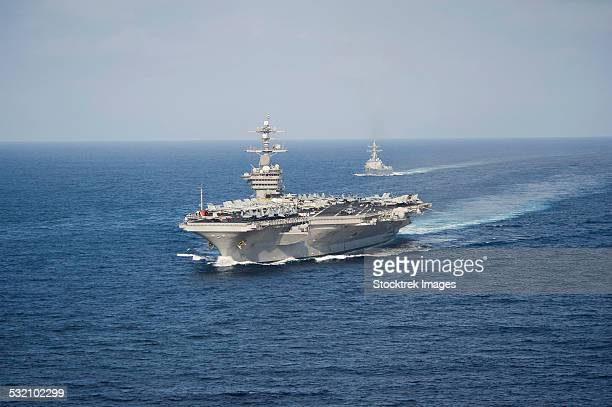 USS Carl Vinson and USS Sterett transit the Pacific Ocean.