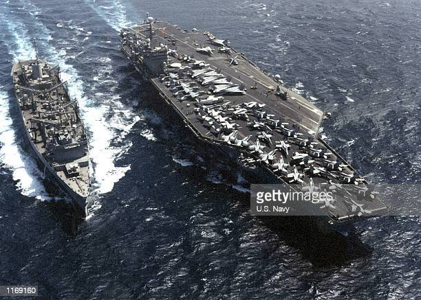 Carl Vinson steams sidebyside support ship USS Sacramento during Operation Enduring Freedom October 12 2001 while at sea