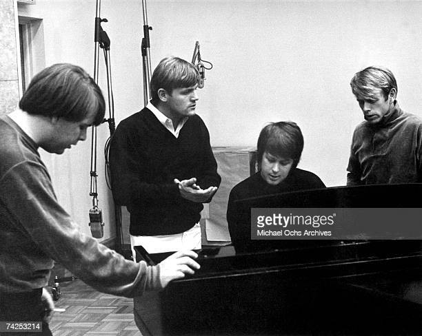 """Carl Wilson, Bruce Johnston, Brian Wilson and Al Jardine of the rock and roll band """"The Beach Boys"""" sing around a piano in the recording studio in..."""