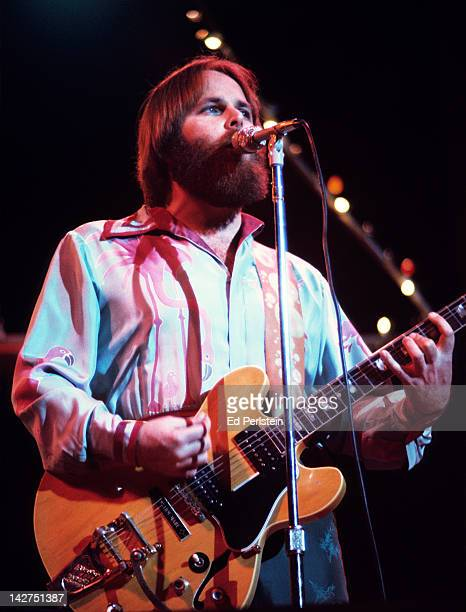 Carl Wilson performs with The Beach Boys at the Oakland Coliseum Arena on December 15, 1976 in Oakland, California.