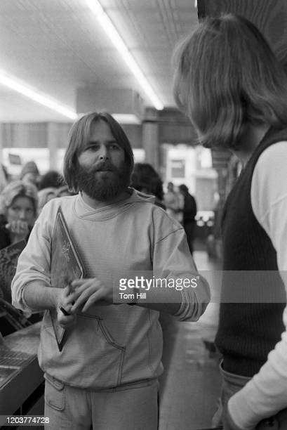 """Carl Wilson prepares to sign autographs at a Beach Boys instore appearance at Peaches Records on January 12, 1977 in Atlanta, Georgia. """"n"""