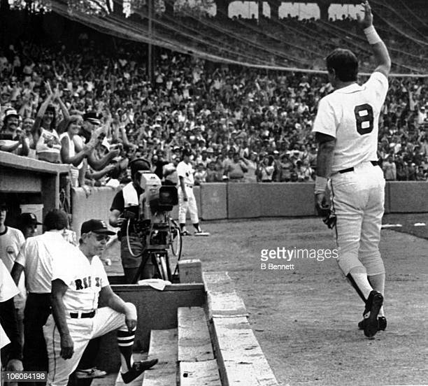 Carl Yastrzemski of the Boston Red Sox acknowledges the fans after he hit a 3run home run in the 5th inning against the Milwaukee Brewers on July 30...