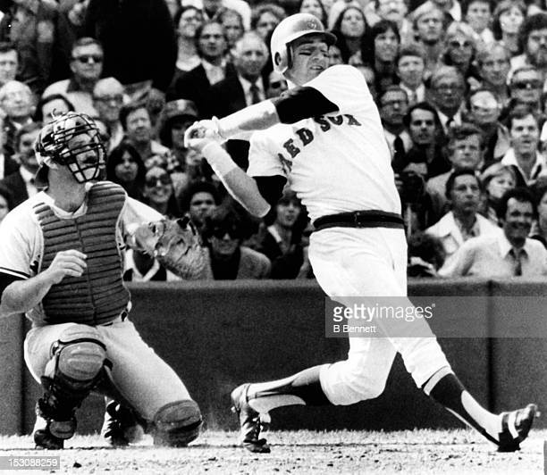 Carl Yastrzemski of the Boston Red Sox hits a home run as catcher Thurman Munson of the New York Yankees watches the flight of the ball on October 2...