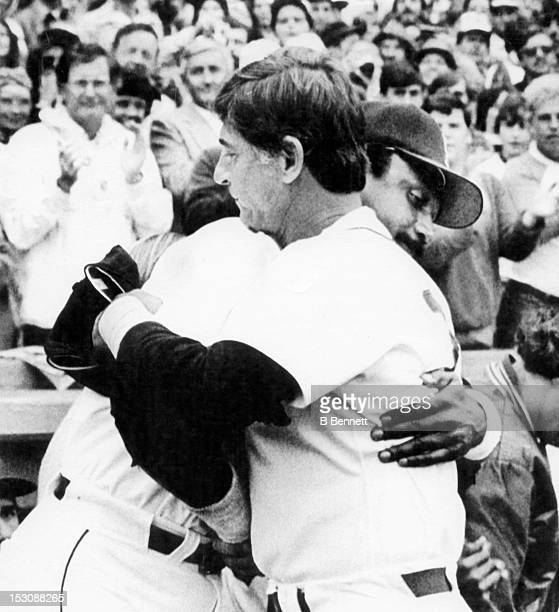 Carl Yastrzemski of the Boston Red Sox hugs his teammate Jim Rice during 'Yaz Day' retirement ceremony before their game against the Cleveland...