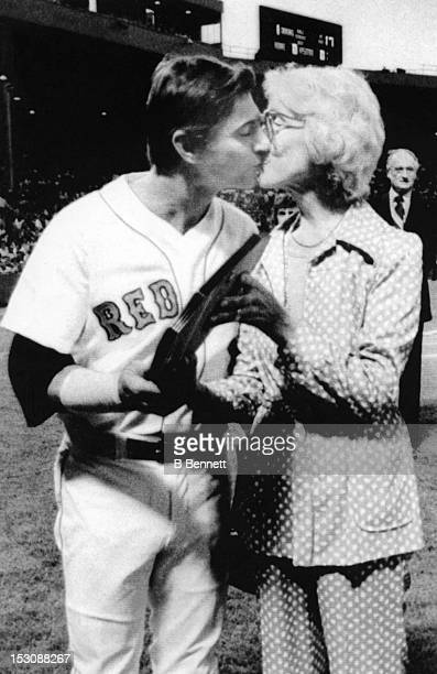 Carl Yastrzemski of the Boston Red Sox kisses Mrs Thomas A Yawkey after she presented him with the first Thomas A Yawkey Memorial Award for...