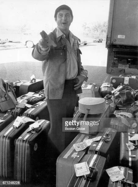 Carl Yastrzemski of the Boston Red Sox looks for his baggage upon arrival at the hotel where the Red Sox are staying for the World Series in...