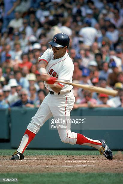 Carl Yastrzemski of the Boston Red Sox steps into the pitch during a 1983 season game at Fenway Park in Boston Massachusetts