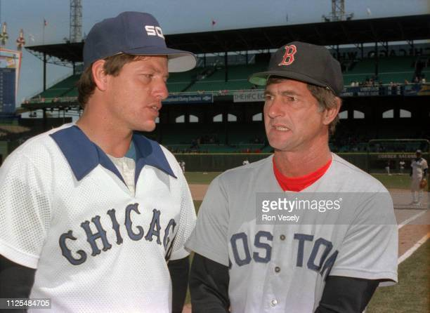 Carl Yastrzemski of the Boston Red Sox talks to Carlton Fisk of the Chicago White Sox before a MLB game during the 1981 season at Comiskey Park in...