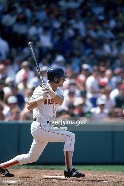 Carl Yastrzemski of the Boston Red Sox watches the flight of the ball as he follows through on a swing during a game in 1982 at Fenway Park in Boston...