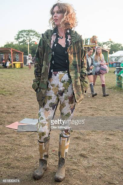 Carla 25 an artist from South Africa wearing a vintage silk shirt her boyfriends army surplus camo print coat trousers by kenzo and Hunter Wellies at...