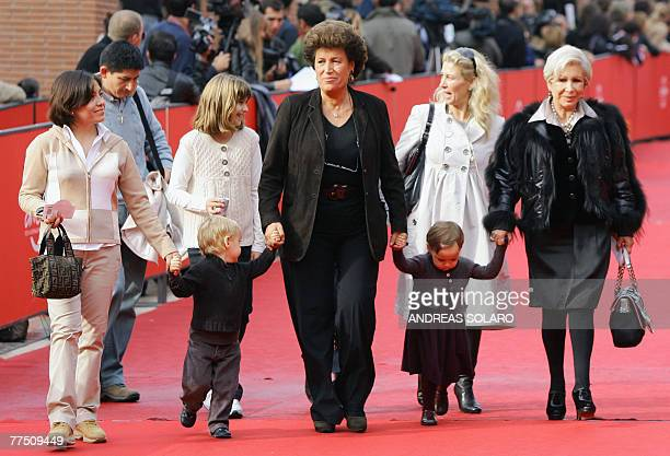 Carla and Anna Fendi the daughters of Edoardo Fendi who founded the Italian fashion house Fendi pose before the screening of 'Enchanted' at the...