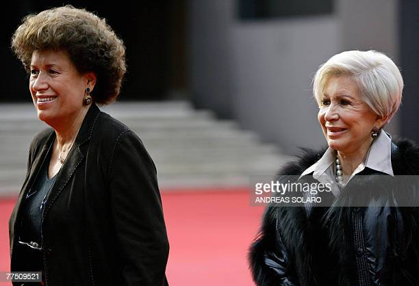 Carla and Anna Fendi the daughters of Edoardo Fendi who founded the Italian fashion house Fendi pose before the screening of Enchanted at the second...