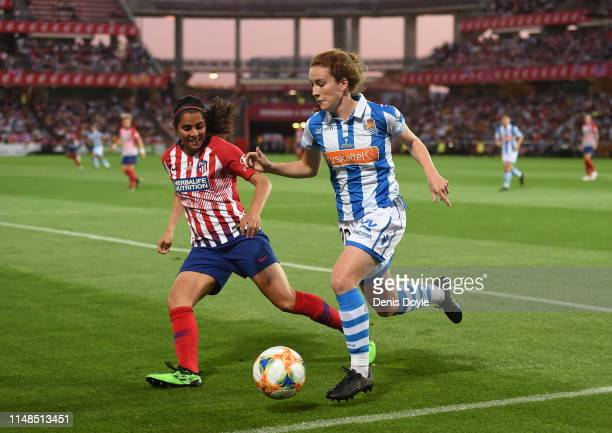 Carla Bautista of Real Sociedad Women clears the ball past Kenti Robles of Atletico Madrid Women celebrates after scoring her team's opening goal...