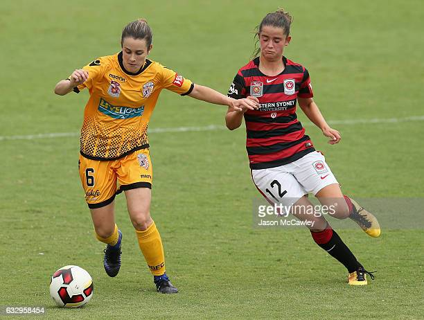 Carla Bennett of the Glory is challenged by Rachel Lowe of the Wanderers during the round 14 WLeague match between the Western Sydney Wanderers and...