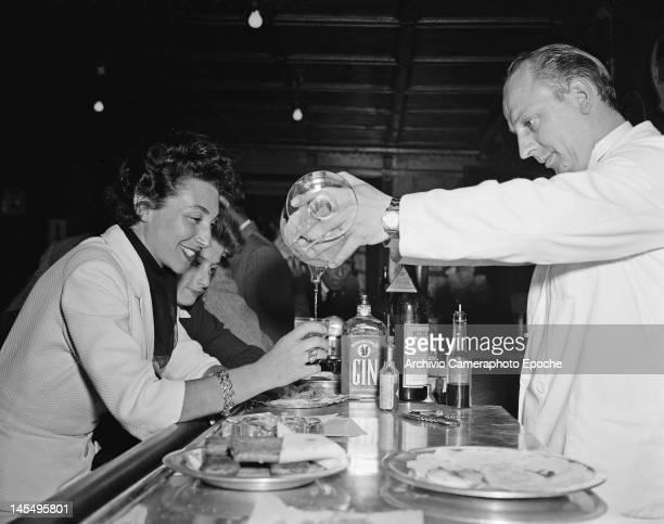 Carla Boschetto enjoys a drink in the Alpine resort of Cortina d'Ampezzo Italy 1951
