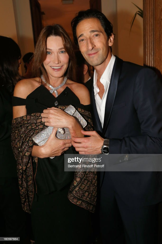 Carla Bruni and Adrien Brody attend the Bulgari and Vogue Party at Apicius Restaurant as part of the Paris Fashion Week Womenswear Spring/Summer 2014 on September 28, 2013 in Paris, France.