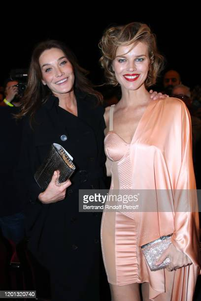 Carla Bruni and Eva Herzigova attends the Jean-Paul Gaultier Haute Couture Spring/Summer 2020 show as part of Paris Fashion Week at Theatre Du...