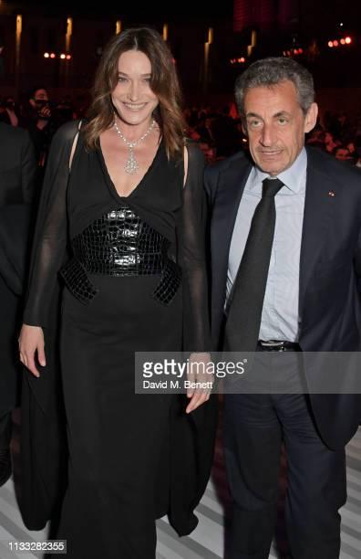 Carla Bruni and Nicolas Sarkozy attend the Fashion Trust Arabia Prize awards ceremony on March 28 2019 in Doha Qatar