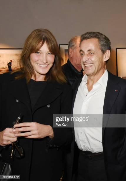 Carla Bruni and Nicolas Sarkozy attend the Simon Bocanegra And Philippe Morillon Exhibition At la Galerie Du Passage Pierre Passebon on October 18...