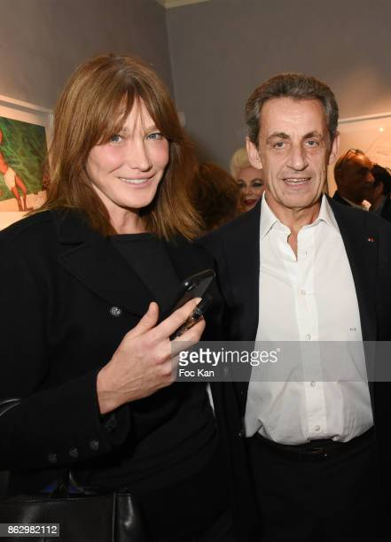 Carla Bruni and Nicolas Sarkozy attend the Simon Bocanegra And Philippe Morillon Exhibition At la Galerie Du Passage Pierre Passebon on October 18...