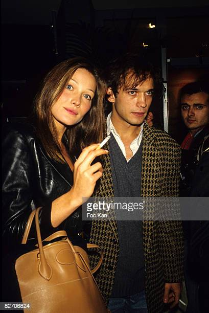 Carla Bruni and Vincent Perez attend the Gianni Versace High Fashion Show at the Ritz Hotel on July 11993 in Paris France