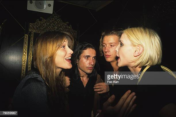 Carla Bruni Arno Klarsfeld A Guest and Nadia Auermann attend the Nadja Auermann Sushi Party at the Bains Club on October 11995 in Paris France