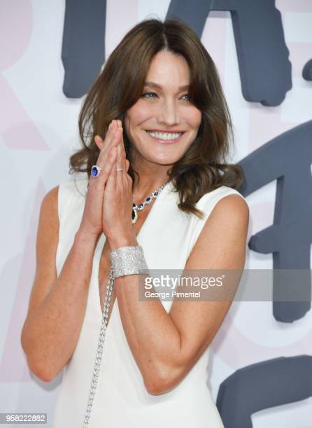Carla Bruni attends Fashion For Relief Cannes 2018 during the 71st annual Cannes Film Festival at Aeroport Cannes Mandelieu on May 13 2018 in Cannes...