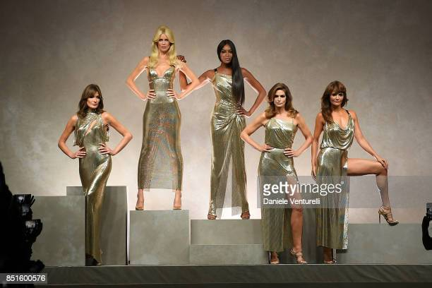 Carla Bruni Claudia Schiffer Naomi Campbell Cindy Crawford and Helena Christensen walk the runway at the Versace show during Milan Fashion Week...