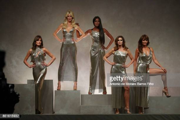 Carla Bruni, Claudia Schiffer, Naomi Campbell, Cindy Crawford, Helena Christensen walk the runway at the Versace show during Milan Fashion Week...