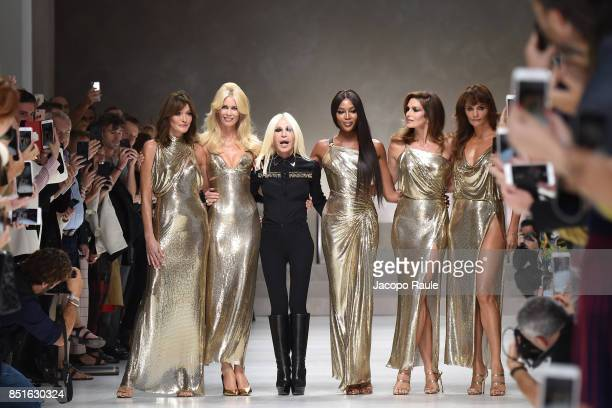 Carla Bruni, Claudia Schiffer, Naomi Campbell, Cindy Crawford, Helena Christensen and Donatella Versace walk the runway at the Versace show during...