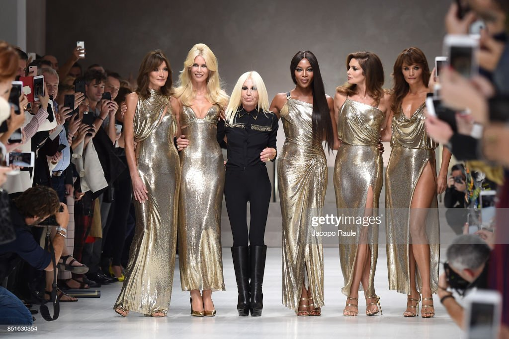 Carla Bruni, Claudia Schiffer, Naomi Campbell, Cindy Crawford, Helena Christensen and Donatella Versace walk the runway at the Versace show during Milan Fashion Week Spring/Summer 2018 on September 22, 2017 in Milan, Italy.
