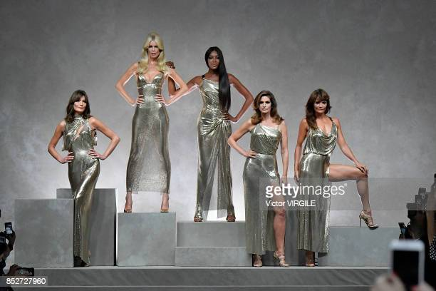 Carla Bruni Claudia Schiffer Naomi Campbell Cindy Crawford Helena Christensen walk the runway at the Versace Ready to Wear Spring/Summer 2018 fashion...
