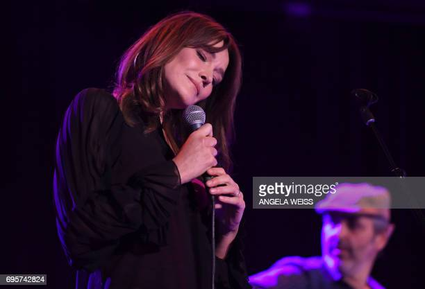 Carla Bruni performs at Poisson Rouge on June 13 2017 in New York City / AFP PHOTO / ANGELA WEISS