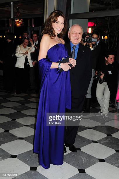 Carla Bruni Sarkozy and Pierre Berge from Yves St Laurent attend the Fashion Dinner For Aids at the Pavillon Armenonville on January 29 2009 in Paris...