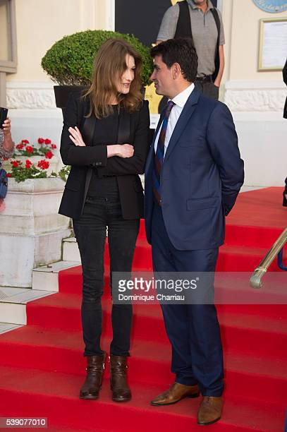 Carla Bruni Sarkozy and Tristan Duval attend the Opening Dinner for the benefit of the association Children of the sun during the 30th Cabourg Film...