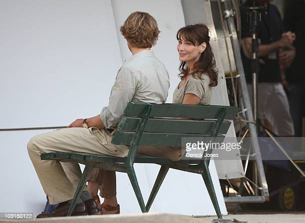 Carla Bruni Sarkozy is seen with actor Owen Wilson during the filming of 'Midnight in Paris' directed by Director Woody Allen on July 28 2010 in...