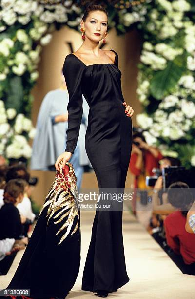 Carla Bruni Sarkozy walks on the catwalks at YSL High Fashion Show Fall/Winter 199697 during the fashion week 1995 in Paris France