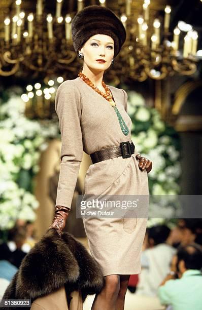 Carla Bruni Sarkozy walks on the catwalks at YSL High Fashion Show Fall/Winter 199697 during the fashion week 1996 in Paris France