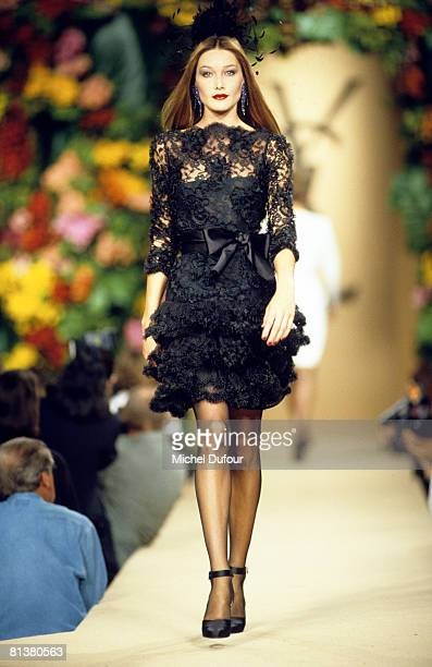 Carla Bruni Sarkozy walkss on the catwalks at YSL High Fashion Show Fall/Winter 199697 during the fashion week 1995 in Paris France